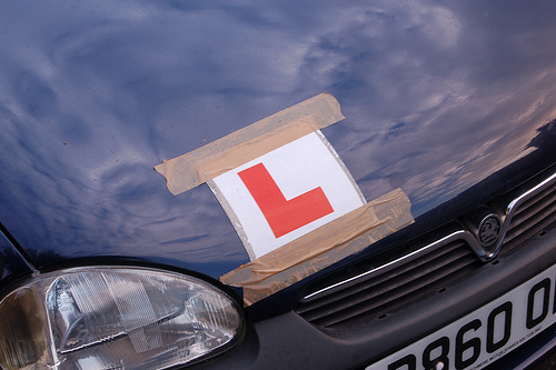 Learner driver plate on the bonnet of a car